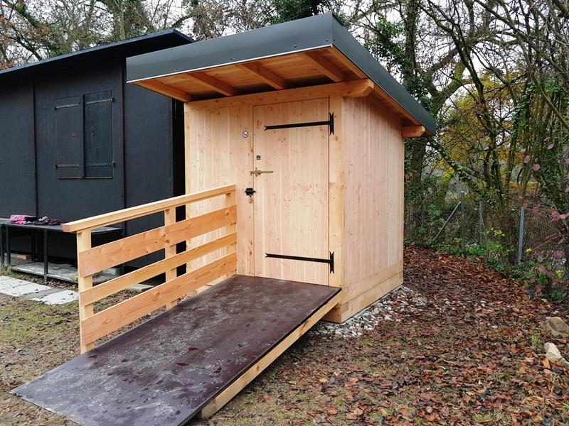 Toilettes Nature s'exporte en Suisse et construit pour un club de tir à l'arc à Genève